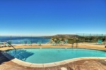 Sparkling, heated pool with an ocean view image