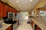 Highly upgraded kitchen with cherry cabinetry, granite counters, and stainless appliances image