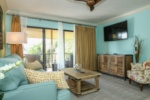 Huge fifty inch flat screen TV in this designer decorated living area w/ balcony views image
