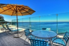 Ocean view deck in front of condo image
