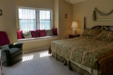Master Suite with King Bed, and private entrance to private covered patio. image