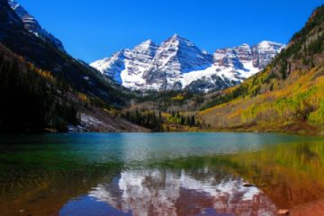 The Maroon Bells Wilderness Area is one of the most photographed areas in North America.  You just might see a moose on your visit to this spectacular (Pic)